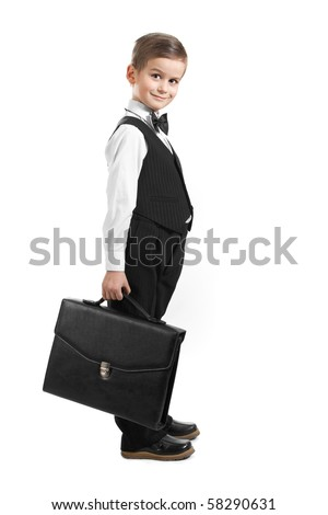 Boy holding a briefcase isolated on white background - stock photo