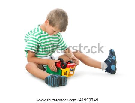 Boy holding a car  isolated on white background - stock photo
