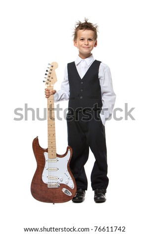 Boy holding a guitar isolated on a white background - stock photo