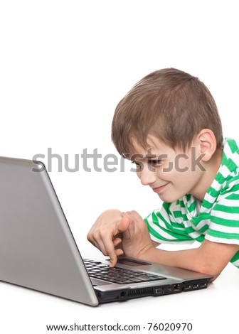 Boy holding a laptop isolated on white background