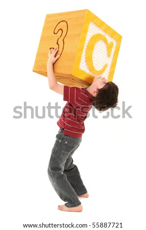 Boy holding a large letter C alphabet block over white.
