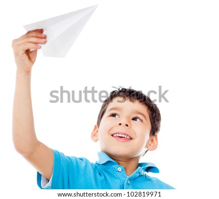 Boy holding a paper airplane - isolated over a white background - stock photo