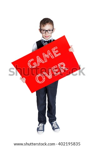 Boy holding a red banner with text Game over isolated on white background