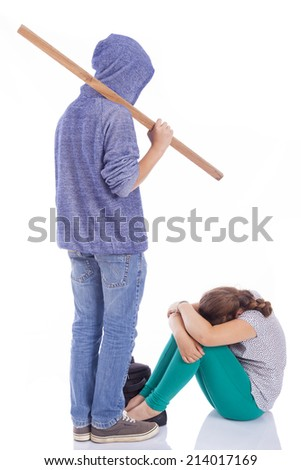 Boy holding a wooden stick for bullying, isolated on a white background - stock photo