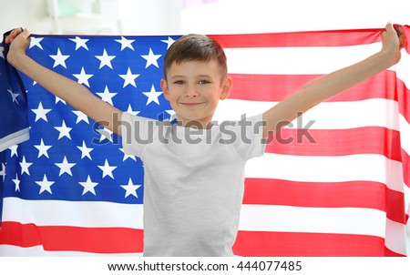 Boy holding American flag - stock photo