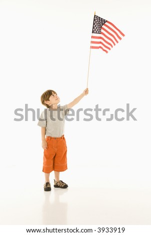 Boy holding American flag against white background. - stock photo