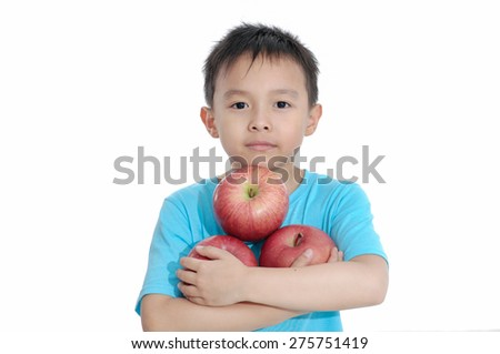 Boy holding an apple isolated  - stock photo