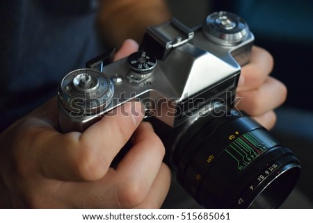 Boy holding an old camera