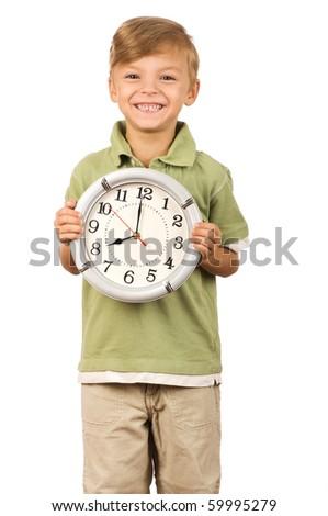 Boy holding big clock isolated on white background - stock photo