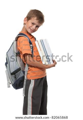 Boy holding books isolated on a white background - stock photo