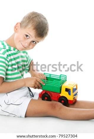 Boy holding car  isolated on white background - stock photo