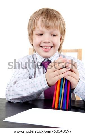 Boy holding color pencils - stock photo