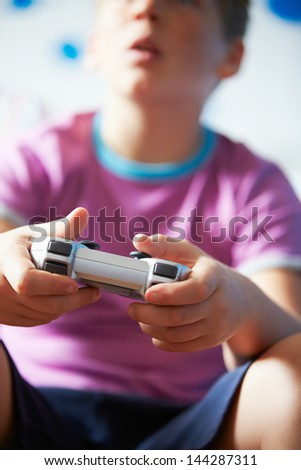 Boy Holding Controller Playing Video Game - stock photo