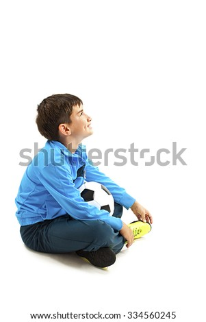 Boy holding football, looking up. Isolated on a white background. Soccer ball - stock photo