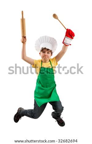Boy holding kitchenware jumping isolated on white background - stock photo