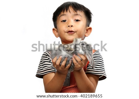 Boy holding rabbit  isolated on the white background.