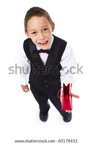 boy holding red bad with a gift in his hands - stock photo