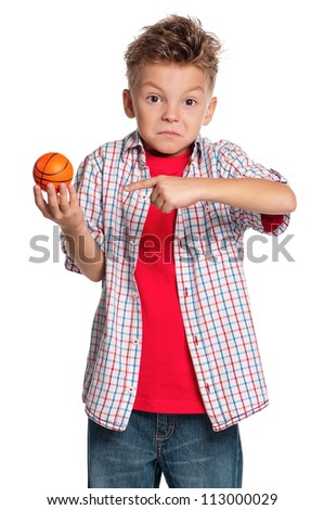 Boy holding small basketball ball in hand isolated on white background - stock photo