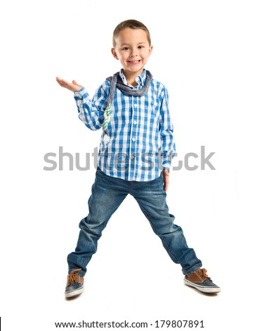 Boy holding something over isolated white background