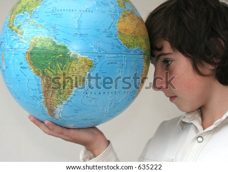 Boy holding the globe