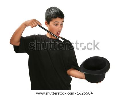 Boy holding wand and magic hat - stock photo