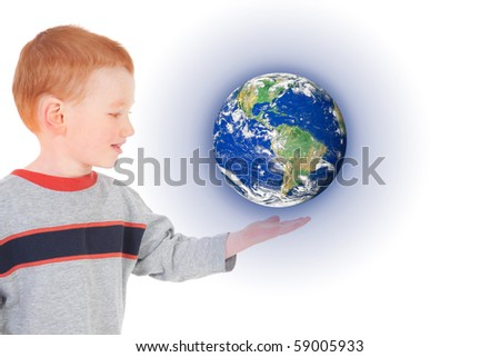 Boy holding world suspended above hand. Isolated on white.