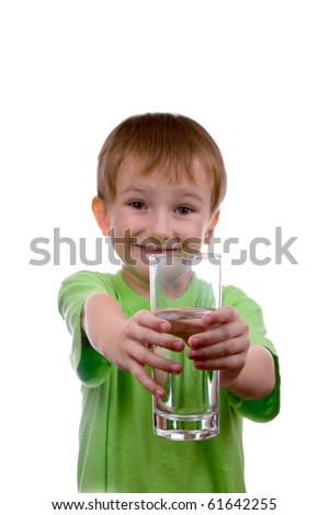 boy holds a glass of water on a white background - stock photo
