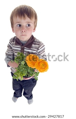 Boy holds flowers out.  Mother's day or spring theme
