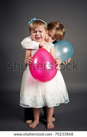 boy hugging a weeping girl - stock photo