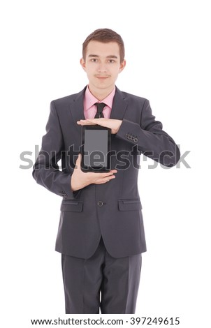 Boy in a black suit hold a tablet PC isolated on white - stock photo