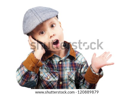 boy in a cap on the phone isolated on white background - stock photo