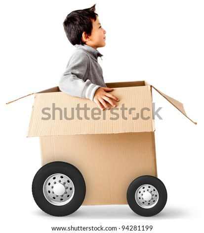 Boy in a car made of cardboard box - express delivery concepts - stock photo