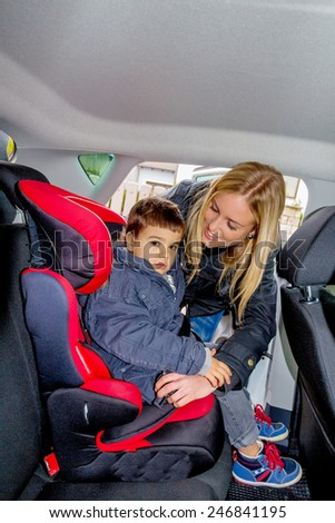 boy in a car seat, symbol of protection, care, vehicle safety - stock photo