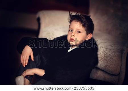 boy in a fur coat - stock photo