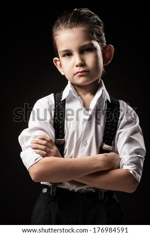 Boy in a gangster on a black background - stock photo
