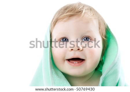 Boy in a green towel isolated on a white background
