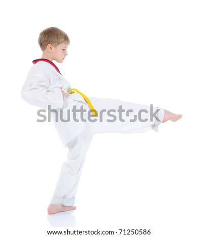 Boy in a kimono punched. Isolated on white background - stock photo