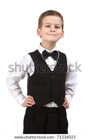 Boy in a suit smiles  isolated on white background