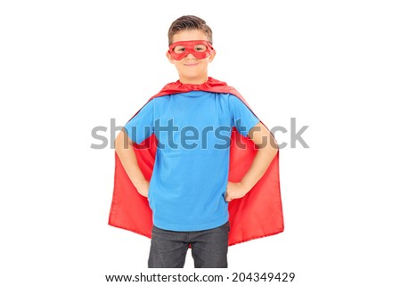 Boy in a superhero costume posing isolated on white background - stock photo
