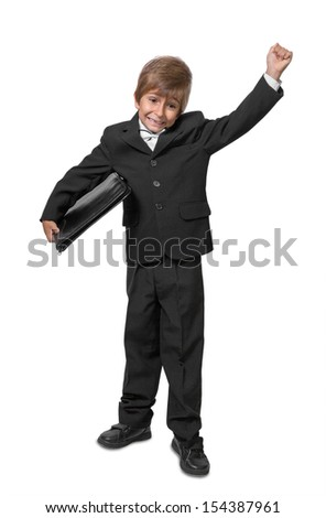 Boy in a tuxedo with a folder in hands. Isolate on white background