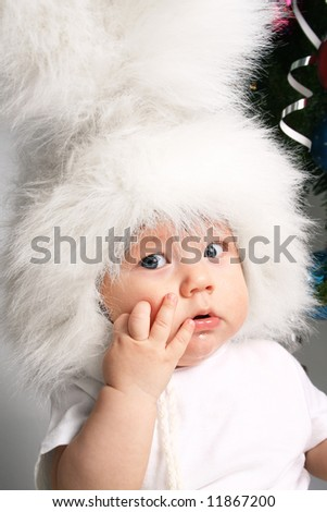 Boy in a white downy bunny costume.