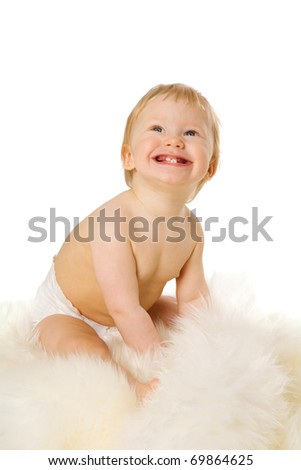 boy in age one year sitting on furs isolated on white