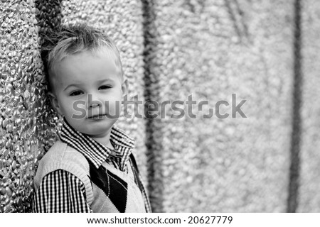 Boy in black and white with graffiti