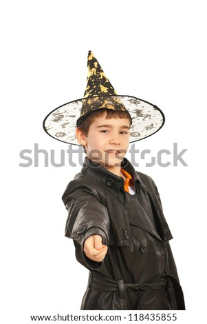 Boy in black jacket and witch hat asing for trick or treat isolated on white background - stock photo