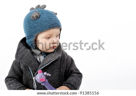 boy in blue hat - stock photo