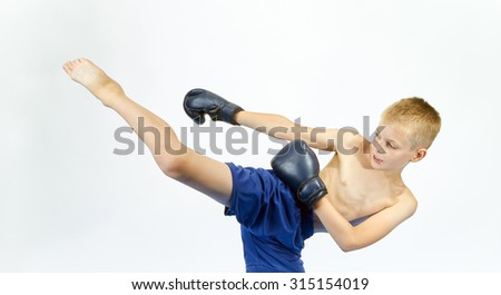 Boy in boxing gloves beats punch leg