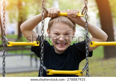 Boy in chains expresses aggression and protest - stock photo