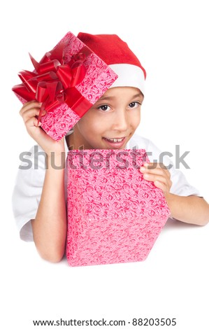 boy in christmas red hat holding a gift box with happy expression on his face with white copyspace to paste your advert or banner isolated on white background - stock photo