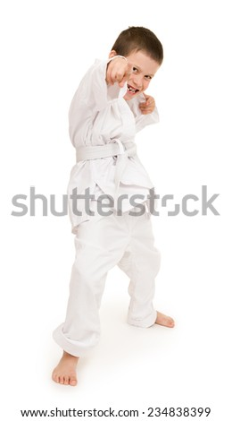 boy in clothing for martial arts - stock photo