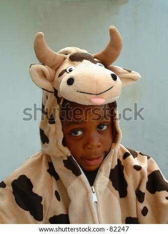 Boy in cow costume